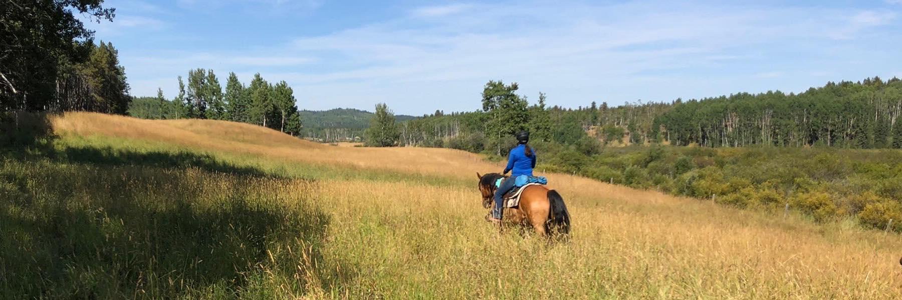 Nadine riding a horse